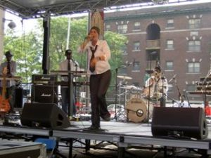 Invincible performs with Platinum Pied Pipers at Detroit Taste Fest, July 4, 2005. (c) Photo by Scott Kurashige.
